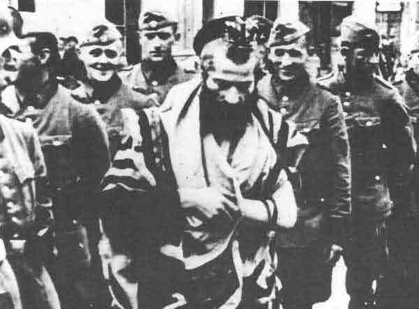 Nazi soldiers harrass Jew