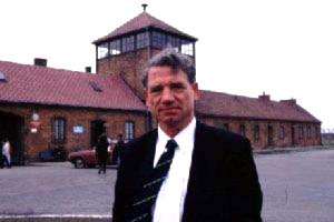 Dr. Toben at the gates of Auschwitz-Birkenau