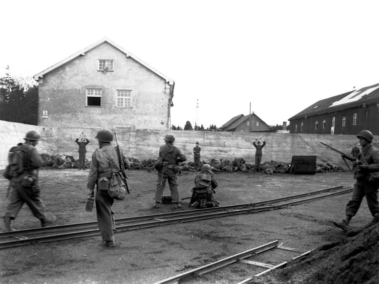 American soldiers summarily kill 520 of the 560 German camp personnel at Dachau