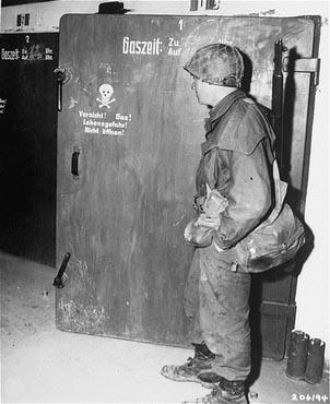 US Army photo of Dachau (Apr. 30, 1945), claiming to show a homicidal gas chamber - yet actually a delousing chamber