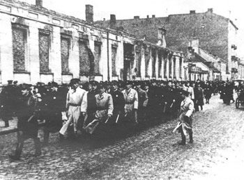 Jewish police of the Warsaw ghetto pass in review