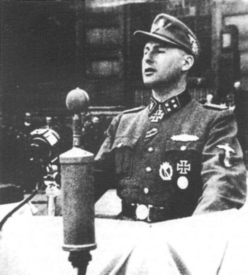 SS officer Leon Degrelle addresses an audience in Brussels, Belgium, 1944