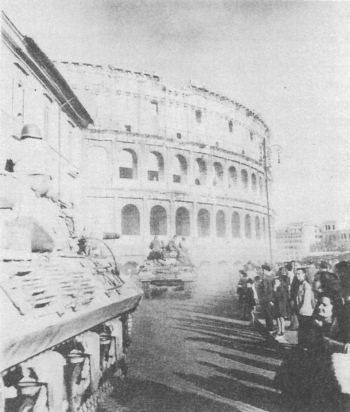 US Fifth Army tanks roar by the ancient Colloseum