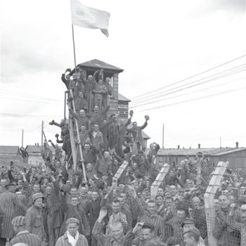 Dachau camp prisoners cheer their American liberators, April 29, 1945