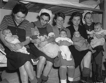 Hungarian Jewish mothers with their babies at Dachau, May 1, 1945