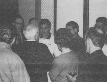 Jürgen Graf speaks with Robert Faurisson during a break, as Fredrick Toben and others look on